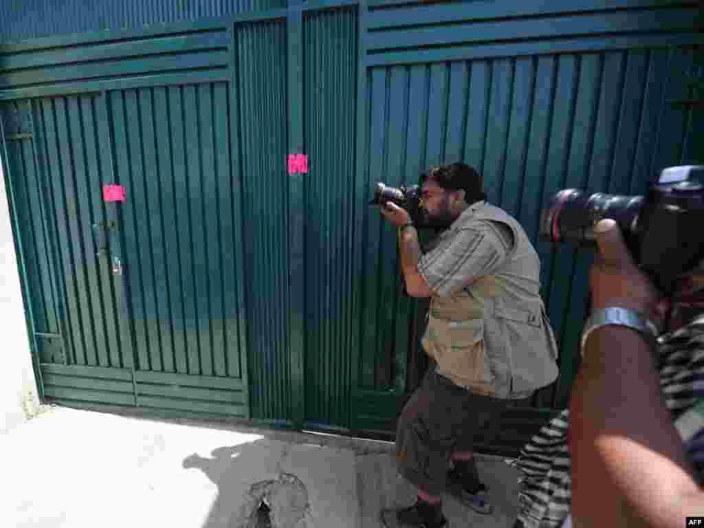 Pakistan - Kuća u kojoj je pronađen i ubijen vođa Al-Qaede, Osama bin Laden, bila je u centru pažnje svjetske javnosti i lokalnog stanovništva, Abbottabad, 03.05.2011.