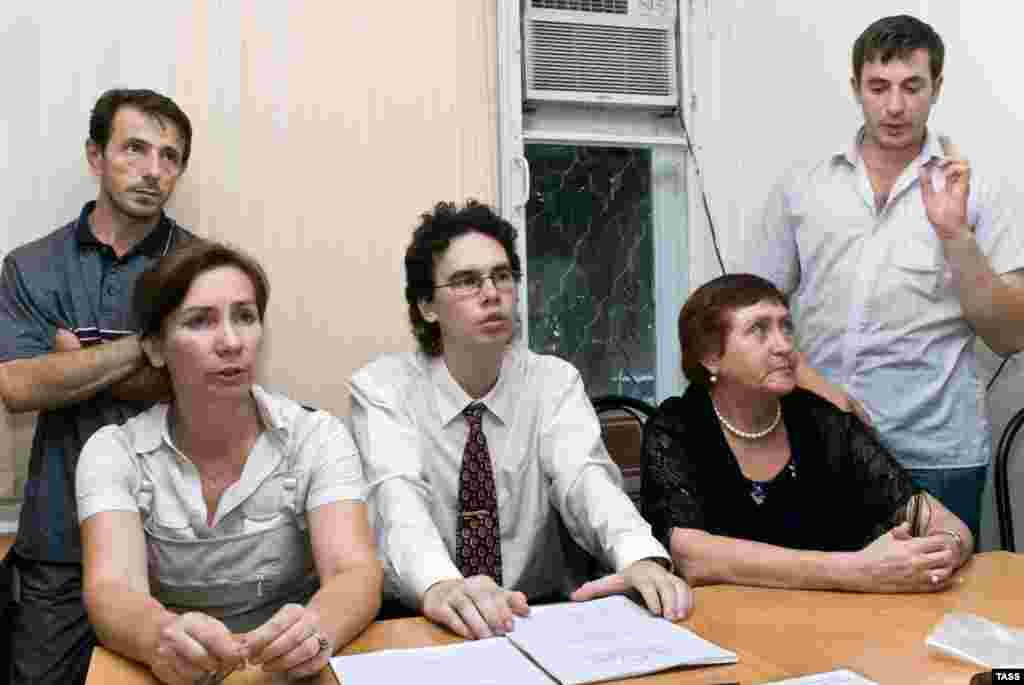 Natalya Estemirova (seated left) with journalists and staff members of the Grozny branch of the Memorial human rights group on July 26, 2007
