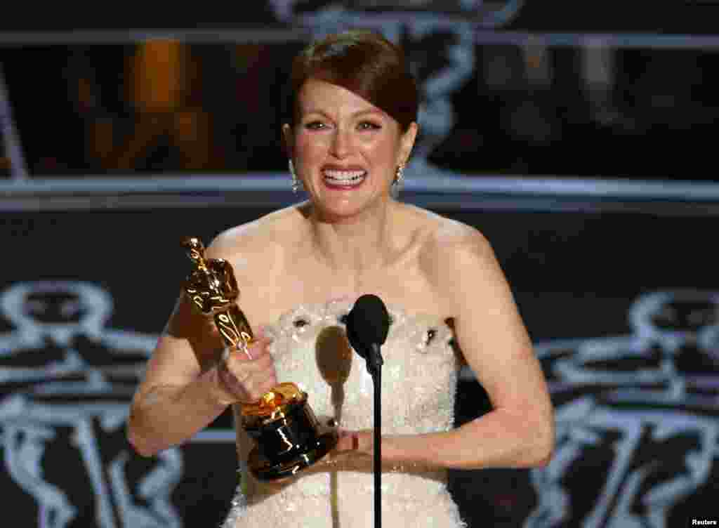 Julianne Moore accepts the Oscar for Best Leading Actress for her role in Still Alice, in which she portrays a 50-year-old with Alzheimer's disease.