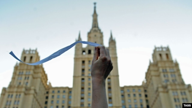 An opposition activist waves a white ribbon on Kudrinskaya Square in central Moscow.