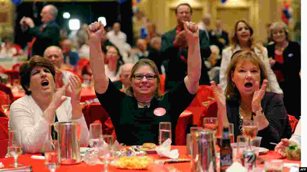 People react as one state's results are called for Republican nominee Mitt Romney during an election night party at The Venetian in Las Vegas, Nevada.