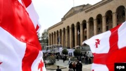 Opposition supporters rally outside the parliament building in Tbilisi on April 17.