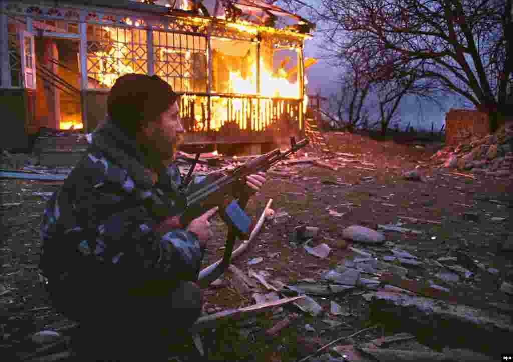 A Russian serviceman during the battle of Komsomolskoye, a village where more than 700 people, many of them civilians, were killed in March 2000. Later that spring Putin, elected president in March and inaugurated in May, imposed direct Kremlin rule over Chechnya.