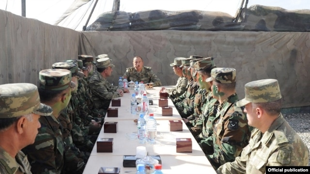 Azerbaijan - President Ilham Aliyev talks to soldiers serving in Agdam district east of Nagorno-Karabakh, 6Aug2014.