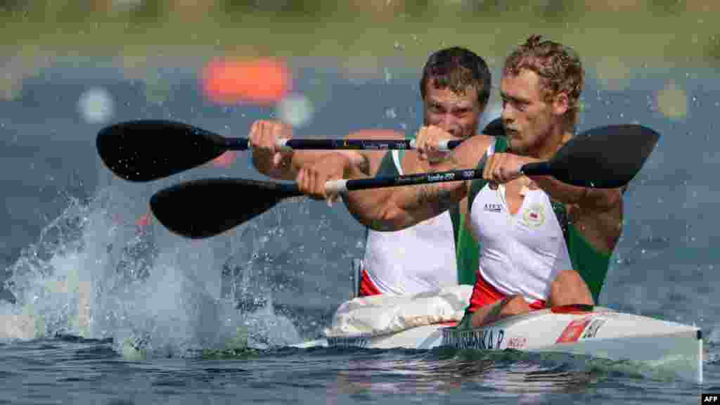 Belarus's Raman Piatrushenka (right) and Vadzim Makhneu compete in the kayak double 200-meter men's heats during the London Olympics. (AFP/Damien Meyer)