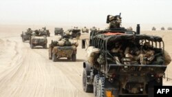 U.S. forces in Kuwait, a major logistics base for operations in neighboring Iraq
