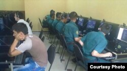 Uzbekistan - military students playing internet games in internet cafe, November 15, 2013.