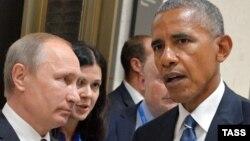 Vladimir Putin (solda) və Barak Obama (2016-cı il)
