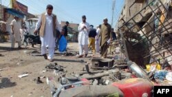 Pakistan -- Security officials examine the site of a bomb explosion in the town of Bannu, in Khyber Pakhtunkhwa province, 12Mar2013