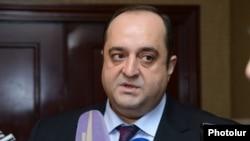 Armenia -- Justice Minister Hovannes Manukian speaks to reporters.