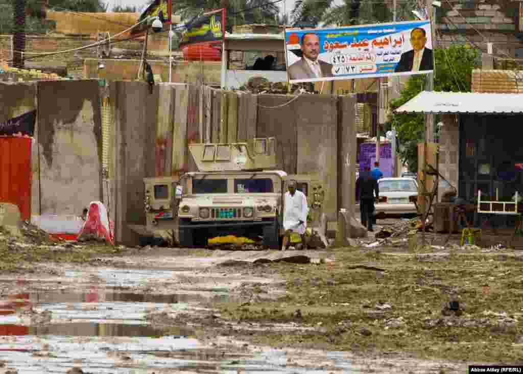 A military vehicle stands at a checkpoint in southern Baghdad after a heavy rain.