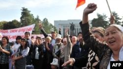 United Kyrgyzstan supporters rally today outside parliament.