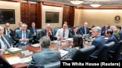 U.S. President Donald Trump and Vice President Mike Pence speak with senior White House advisors during a meeting about an Iran missile attack on U.S. military facilities in Iraq, in the Situation Room of the White House, Washington, U.S., January 7, 2020