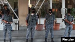 Armenia - Armed police officers guard the entrance to a hospital in Yerevan where opposition gunmen wounded by secrity forces are receiving medical aid, 29Jul2016.