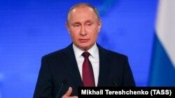 Владимир Путин во время выступления с ежегодным посланием. Фото ТАСС
