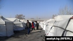 Residents of the village of Shark who lost their homes this summer still live in tents as temperatures drop.