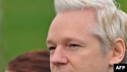 WikiLeaks founder Julian Assange arrives at Belmarsh Magistrates' Court, in southeast London, on February 7.