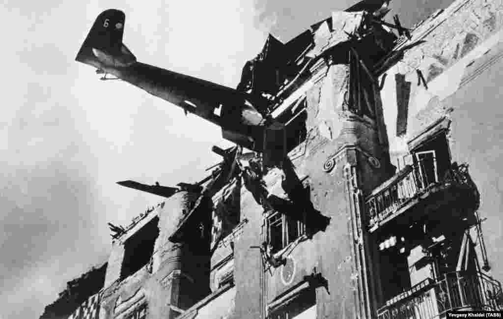 A Nazi plane that had slammed into an apartment block in Budapest, photographed in 1945.