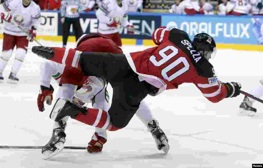Canada's Jason Spezza (front) challenges Oleg Yevenko of Belarus during their Ice Hockey World Championship quarterfinal game in Prague on May 14. (Reuters/David W. Cerny)