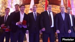 Armenia - Former President Robert Kocharian (second from right) and Prosperous Armenia Party leader Gagik Tsarukian at an awards ceremony organized for prominent Armenian athletes near Yerevan, 26Dec2013.