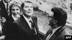 U.S. President Ronald Reagan tours the Berlin Wall before delivering his speech.