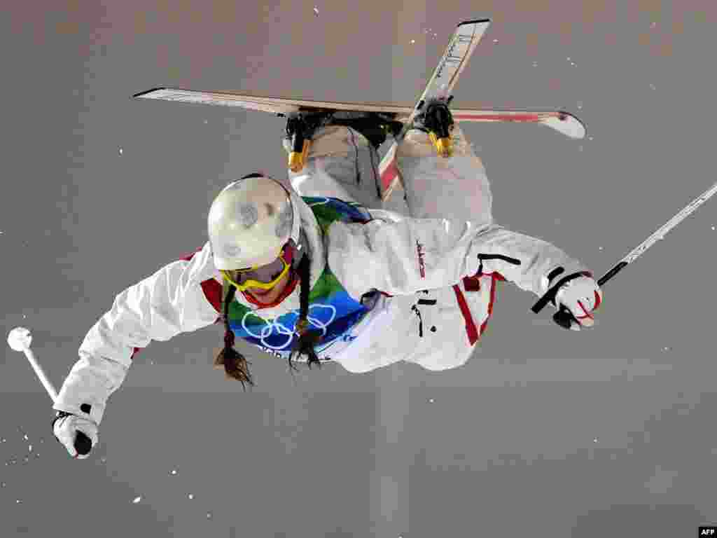 Russia's Ekaterina Stolyarova jumps during the women's moguls freestyle skiing final at the Olympic Games. - Photo by AFP