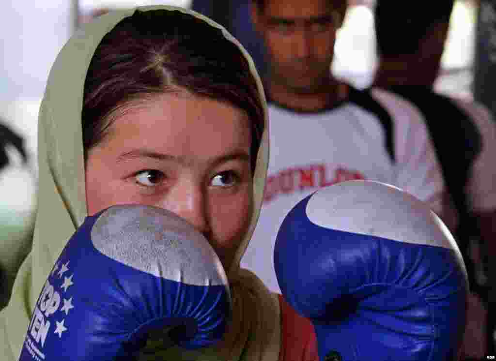 Afghanistan -- A female boxer akes part in a practice session in preparation for the London 2012 Olympics at a gym in Kabul, 09Aug2011