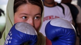 A female boxer takes part in a practice session in preparation for the London 2012 Olympics at a gym in Kabul.