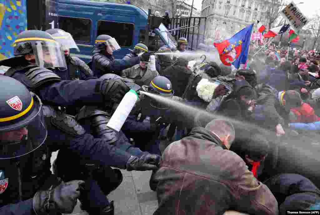 French riot police spray tear gas on demonstrators during clashes on the Champs-Elysees in Paris. Thousands demonstrated against France's gay marriage law in an attempt to block legislation that will allow homosexual couples to marry and adopt children. (AFP/Thomas Samson)