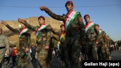 Kurdish Peshmerga fighters in Irbil take part in a rally in support of an independence referendum on September 13.
