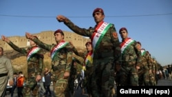 Kurdish Peshmerga fighters in traditional uniforms take part in a march to support an independence referendum in Irbil on September 13.