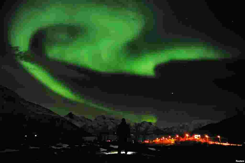 The aurora borealis lights up the sky near the city of Tromsoe in northern Norway on January 25. Reuters/Rune Stoltz Bertinussen/Scanpix