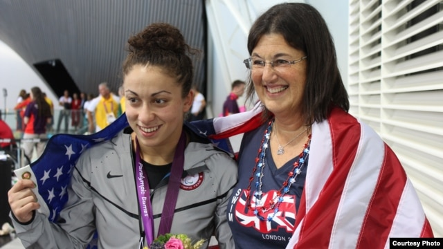 Georgia-born U.S. Paralympic swimmer Elizabeth Stone (left) with her adoptive mother, Linda, at the London 2012 Games.