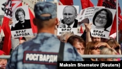 "A rally against pension reform in Moscow on September 22. The placards read ""Public Enemy"" and show President Vladimir Putin (center), Federation Council speaker Valentina Matviyenko (left), and Central Bank Governor Elvira Nabiullina."