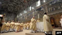 Vatican -- This handout picture released by the Press office shows Pope Francis (c), Argentina's Jorge Mario Bergoglio, leading a mass at the Sistine Chapel a day after his election, 14Mar2013