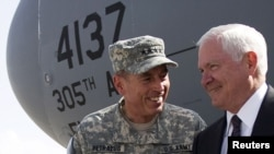 U.S. General David Petraeus (left) greets Defense Secretary Robert Gates in Kabul.