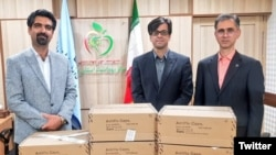 Zoroastrian Parsis from India brought medical supplies for Iran to fight coronavirus. A leader of Iran's Zoroastrian community, Sepanta Niknam (L) March 25, 2020