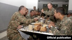 Armenia - Defense Minister Seyran Ohanian (L) dines with soldiers at a military base in Tavush province, 20Aug2013.
