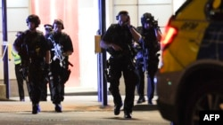 Armed police take position at the scene of a deadly incident on London Bridge described as a terrorist attack that killed at least six people.
