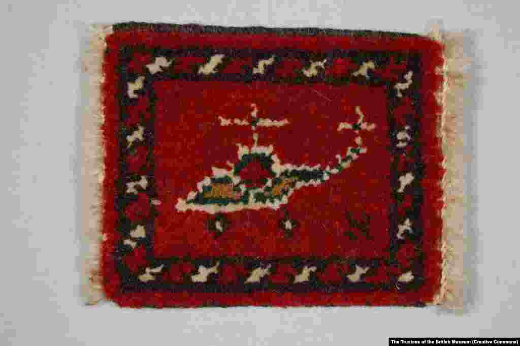 A foot rug decorated with a Soviet helicopter.