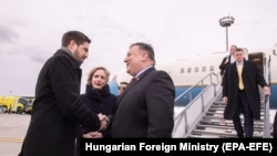 U.S. Secretary of State Mike Pompeo (center) is welcomed upon his arrival at Liszt Ferenc International Airport in Budapest on February 11.