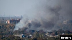 Smoke rises above a residential area after recent shelling near Donetsk airport during fighting between pro-Russian separatists and Ukrainian government forces.