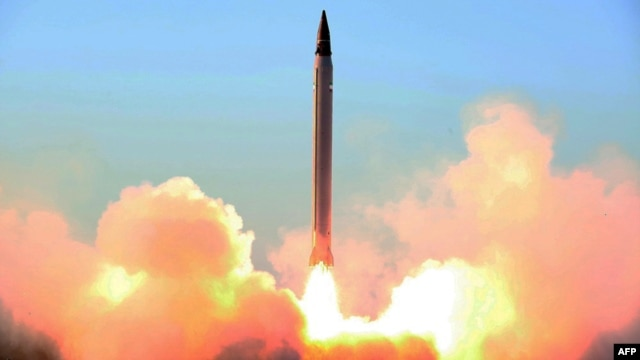 The launch of an Iranian Imad missile during tests at an undisclosed location in Iran on October 11.