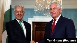 #US Secretary of State Rex Tillerson (R) shaking hands with Pakistan's Foreign Minister Khawaja Muhammad Asif before their meeting at the State Department in Washington on October 4.