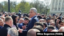 North Ossetian leader Vyacheslav Bitarov addresses people protesting against a coronavirus lockdown in Vladikavkaz on April 20.
