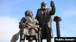 The monument to Abai Kunanbaev (left) and Yevgeny Mikhaelis in Oskemen was widely ridiculed as disproportionate and ugly.