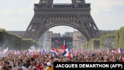 France supporters cheer near Eiffel Tower in Paris.