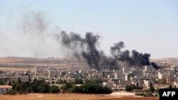 Клубы черного дыма над Кобани