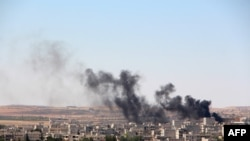 Syria -- Smoke billow from the Syrian town of Kobani, June 25, 2015