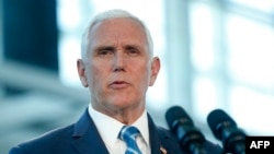 (FILES) In this file photo taken on June 18, 2019 US Vice President Mike Pence addresses media and guests at a press conference to address the US Naval Hospital Ship Comfort at the Port of Miami in Miami, Florida.